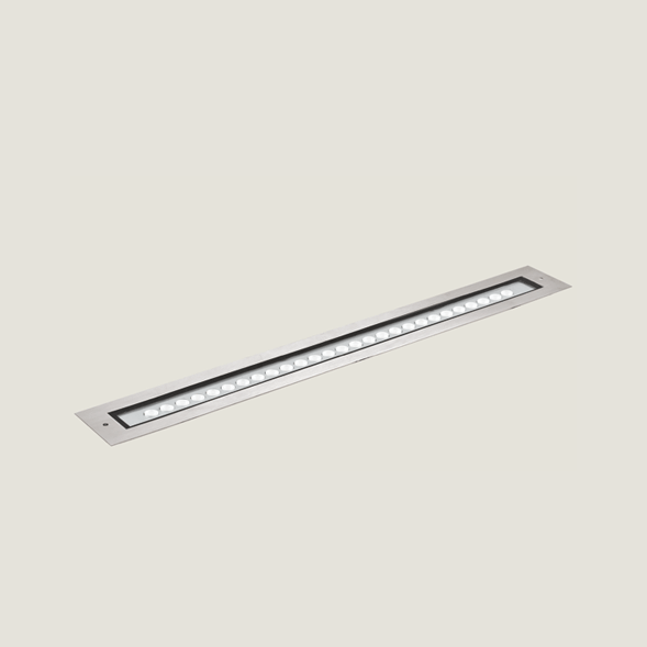 A large aluminium outdoor on floor light with a grey background.
