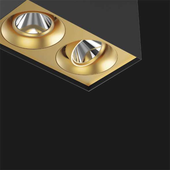 A black and gold suspended box pendant light on a black background.