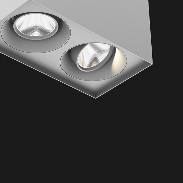 A grey suspended box pendant light on a black background.