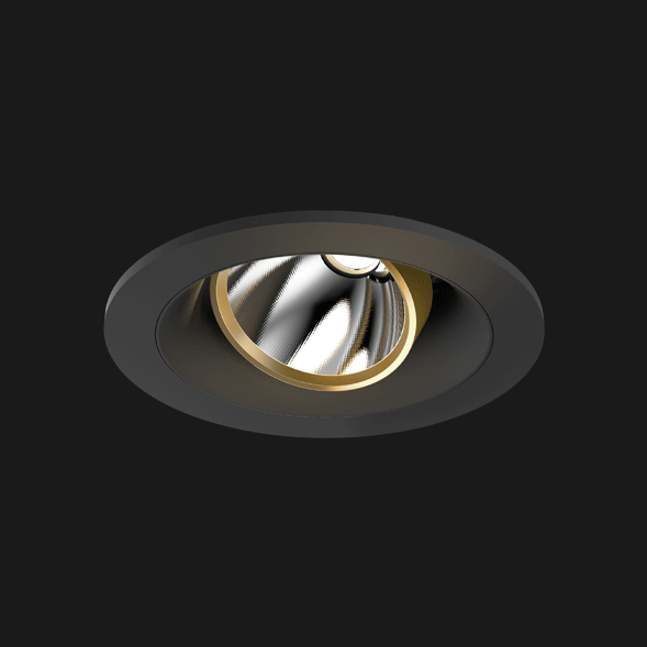 A gold and black round led downlight with black background