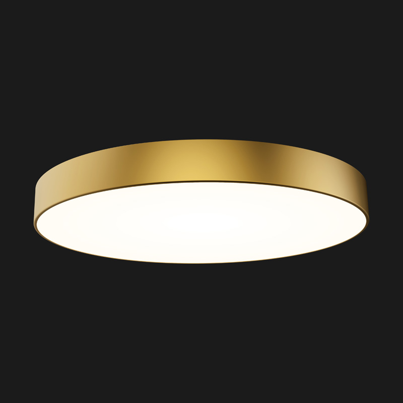 A gold round pendant light with black background.