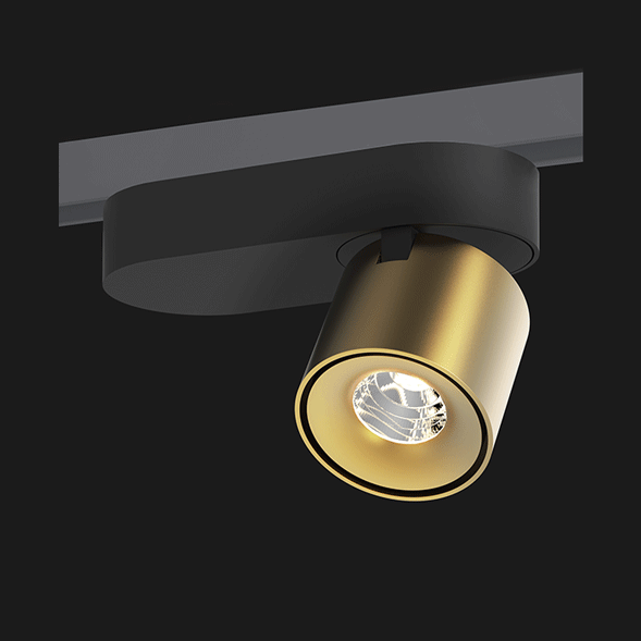 A black and gold track lights with a black background.