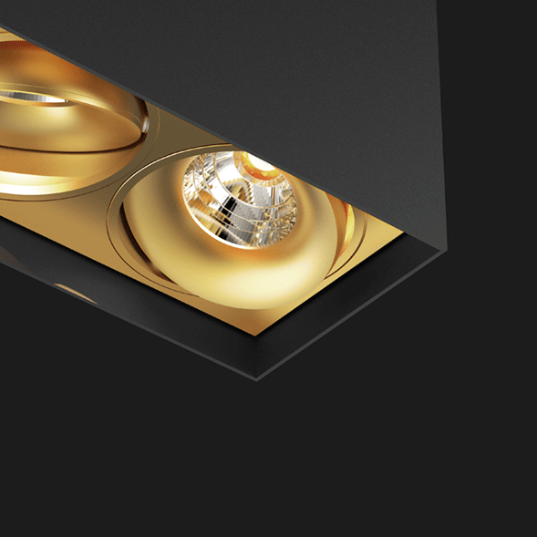 Black and gold suspended box pendant light on a black background