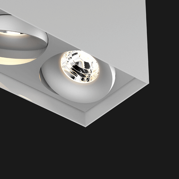 Grey suspended box pendant light on a black background