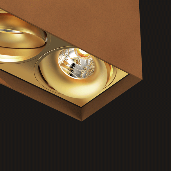 Corten and gold suspended box pendant light on a black background