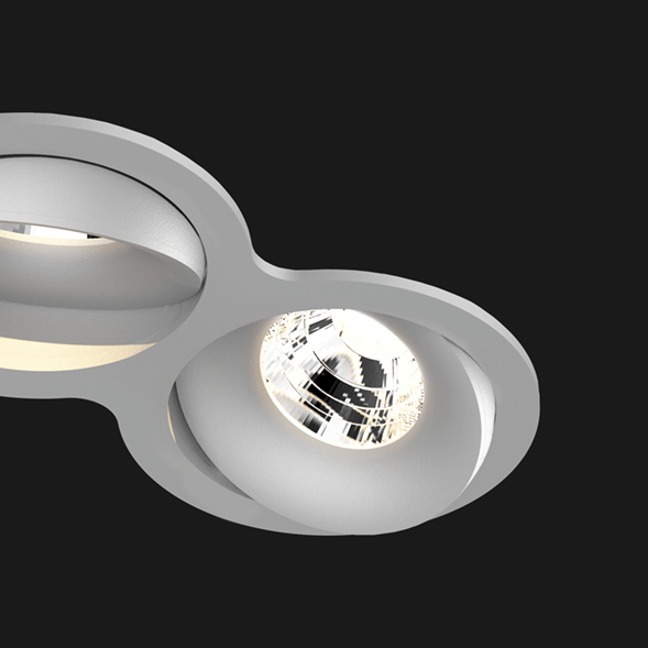 A grey double 8 led downlight with black background
