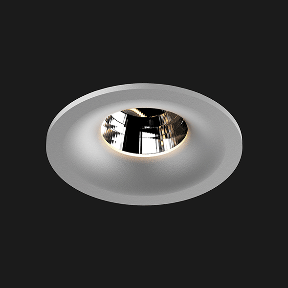 A grey round fix led downlight with black background