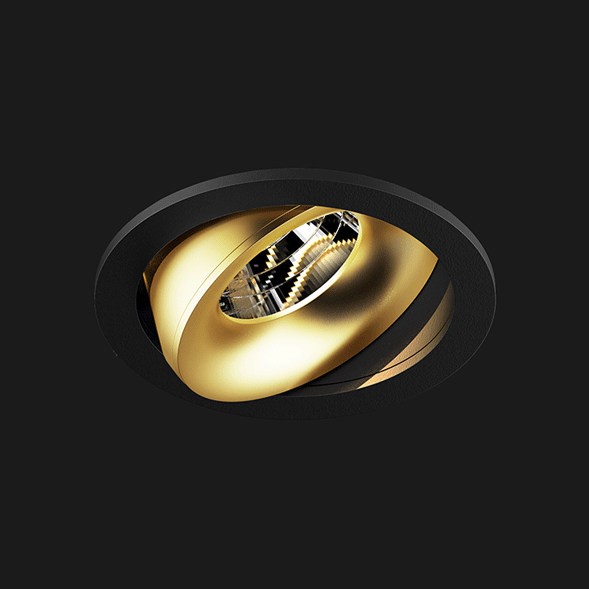 A black and gold round led downlight with black background