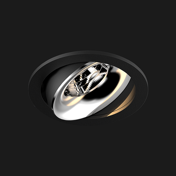 A black and chrome round led downlight with black background