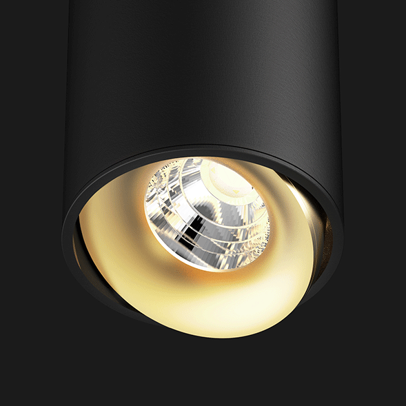 Black and gold ceiling light on a black background