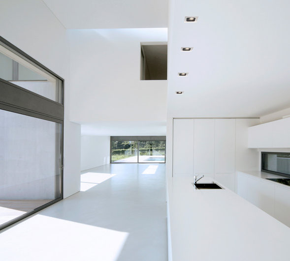 A white modern kitchen with led downlights