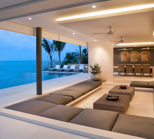 A luxury living room with ocean views sofas and led downlights