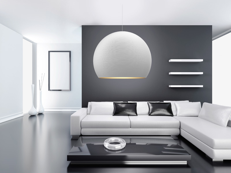 A moder design living room with a white sphere pendant light.