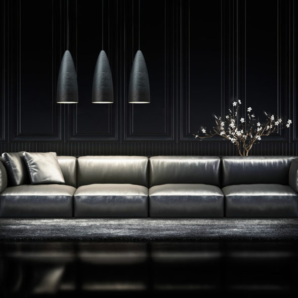 A black modern design sofa with 3 black pendant lights.
