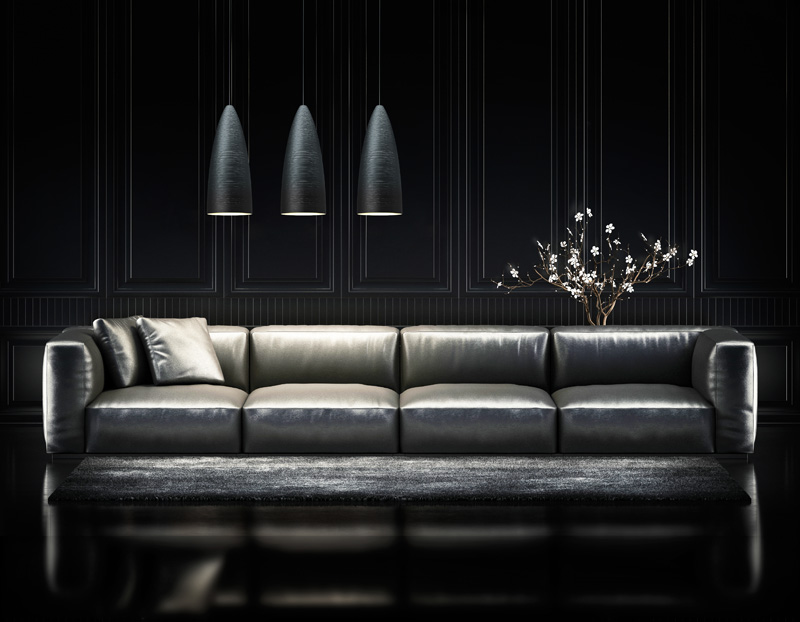 A black modern design sofa with 3 black pendant lights.