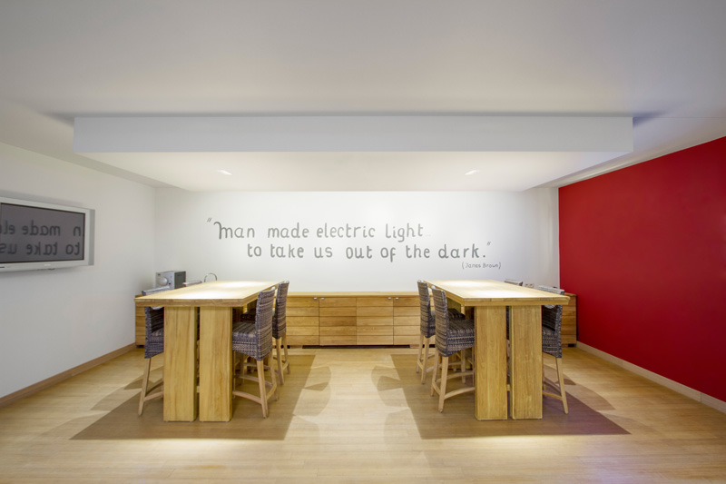 A stylish office space with two wood tables and 3 led downlights
